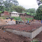 End of july concrete was placed on the foundation of the boys dormatory.