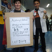 Students advertising their selfmade schokolade Santa Claus.