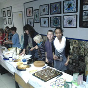 Students selling selfmade cake to the visitors.