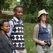 German and tanzanian colleagues watching the activities on the school yard.