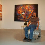 "Sitting in front of ""ENERGY"" at the Milou Gallery in Miami. 2008."