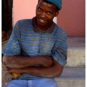 To be employed in South Africa in 2003, Young Worker takes a break, Bo Kaap Section, Capetown, SA 2003