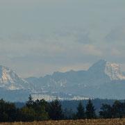Blick auf verschneite Alpen - bei einer Radtour