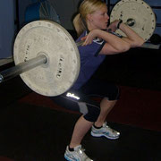 Demonstrating a front squat