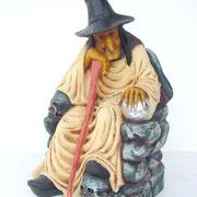 bruja sentada
