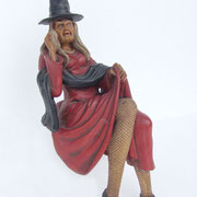 bruja sentada sexy