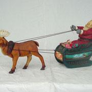 santa claus con trineo y reno