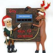 figura de elfo y reno