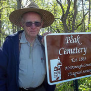 Richard Jackson, genealogist and descendant of relatives resting in the Peak Cemetery, accepts a new sign marking the burial site donated by the McDonough County Historical Society.