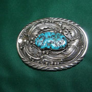 Artist Unknown.     Turquoise buckle.