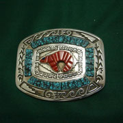 Calvin Begay [ Navajo ] Active since 1983. Traditional and contemporary; sand casting; mosaic and channel inlay; cobblestone.  Turquoise & coral  inlay Buckle
