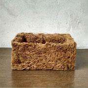 Maceta en fibra de coco.
