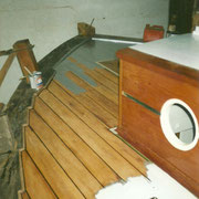 After caulking we covered it all with a coat of aluminium paint to seal the bitumen, before applying the deck paint.