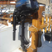 Tohatsu 3.5HP stowed on support on deck
