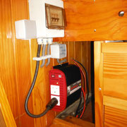 220V fusebox and inverter, situated port side middle cabin next to companionway