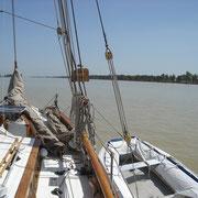 dinghy hoisted alongside - with anti-UV cover