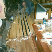 The deck seams are caulked with cotton, then payed with bitumen (Jefferey's marine glue).