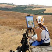Maria painting on location in the Italian countryside