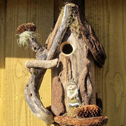 """Humlegaard"" customized Alpine bird house hanging on a tree farm on Fyn (Europe)"