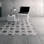 "Break a large space into orderly sections with patterned tile ""rugs""."