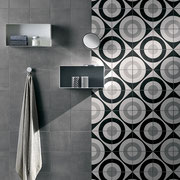 A dramatic swatch of concentric circles for a bold feature wall in this shower.