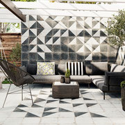 Blend a geometric shape, such as these triangular color blocks, with solid field tiles to evoke fractals, prisms, and fluttering, falling leaves.