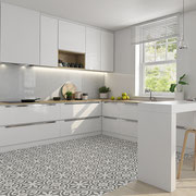 An all-white kitchen can be boring, so add some style with a patterned floor! It's great for hiding dirt and dog hair.