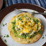 breakfast tostadas with egg, avocado, cheese, and green onion