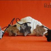 Mobile Stern, Wildlederband (ohne Details 22,00 € *, mit Details 24 € *)