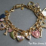 """П-884. Красивый браслет """"Sweet Hearts"""" от американской компании Киркс Фолли. Разнообразные подвожные чармы, позолота 22К, декор австрийскими бусинами, кристаллами Сваровски, эмалями.ПОВТОР ПОД ЗАКАЗ"""