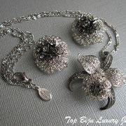"""П-846. Комплект """"Орхидеи"""" от американского дизайнера Нолан Миллера. Ювелирный сплав с родием, декор камнями Сваровски."""