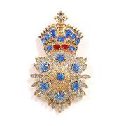П631.Брошь-орден в геральдическом стиле от американского дизайнера Джоан Риверс (см раздел Имена). Австрийские кристаллы, ювелирный сплав под золото.