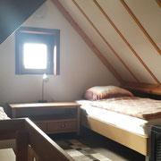 Schlafzimmer Nr 3 im Dachgeschoss