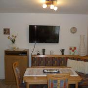 gemütliche Wohnküche in der Fewo Gänseblümchen, Sitzecke