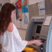 Rachel using ATM to get Euros in Rothenburg