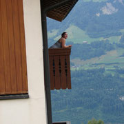 Abbi on hotel balcony in Swiss Alps