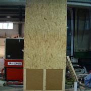 Werksbefüllung von Wandelementen mit Holzfaser Einblasdämmstoff