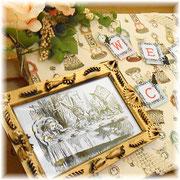 不思議の国のアリスのウェルカムボード_04 枠はマカロニに金色のペンキを塗ったもの