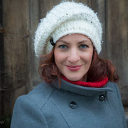 Frauenporträt mit Wollmütze