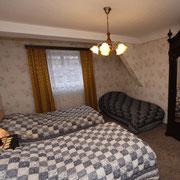 Chambre avec 3 lits 1 personne
