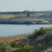 am Strand mit Blick auf den Torre  su Putto