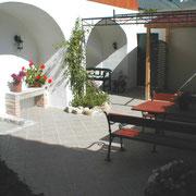 The sunny backyard with mediterranean flair.