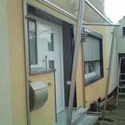 Edelstahl-Glasvordach mit Seitenteilen