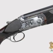 Ripa incisione manuale di lusso, ornato con rimesso in oro e soggetti, bulino, punta e martello, bascula fucile da caccia