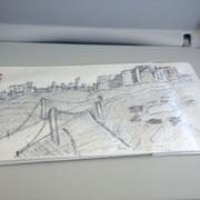 Dessin d'une ville réalisé dans l'avion sur un sac à vomir !