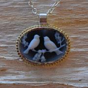 Kammee mit Vögelchen in Silber mit 750er Goldrand