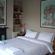 """Chambre du logement avec un lit """"King Size"""""""