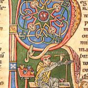 Lettre historiée : le moine enlumineur s'est représenté à l'ouvrage dans l'initiale