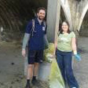 IOI SA Director Adnan Awad and IOI SA assistant Shannon Hampton engaged in clean-up activities at Kalk Bay, South Africa