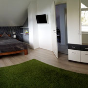 Schlafzimmer 1 im OG Ferienhaus Seepromenade in Storkow